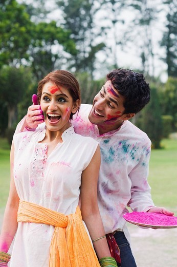 Couple celebrating Holi : Stock Photo