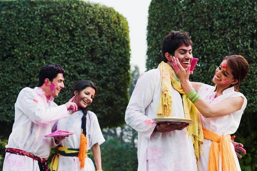 Couples celebrating Holi : Stock Photo