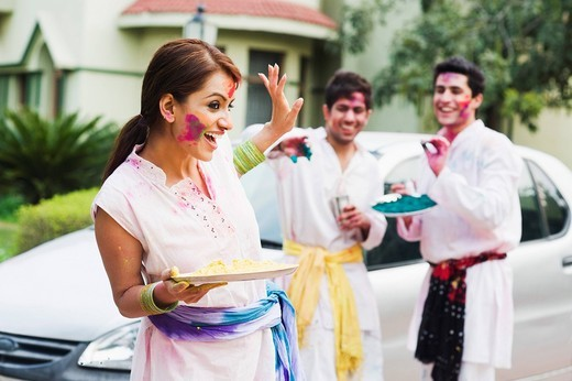 Friends celebrating Holi : Stock Photo