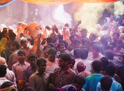 Group of people celebrating Holi festival, Barsana, Uttar Pradesh, India : Stock Photo