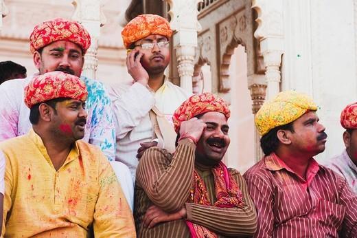 Stock Photo: 1846-12208 Group of men celebrating Holi festival, Barsana, Uttar Pradesh, India