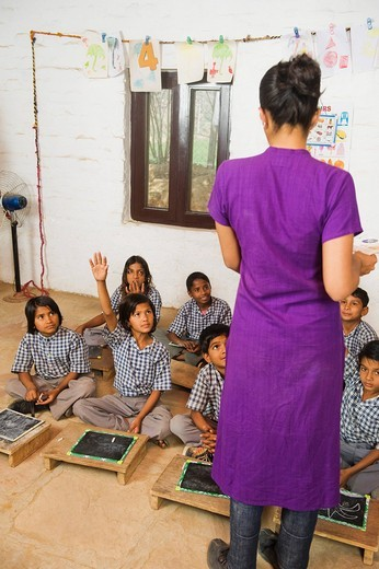 Stock Photo: 1846-12866 Woman teaching students in a classroom