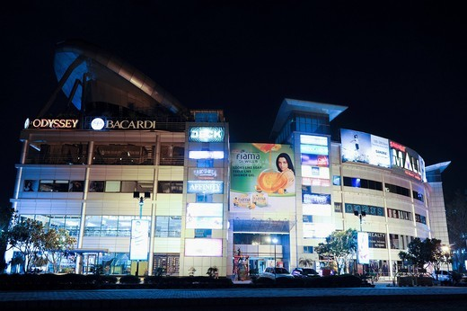 Shopping mall lit up at night, Sahara Mall, MG Road, Gurgaon, Haryana, India : Stock Photo