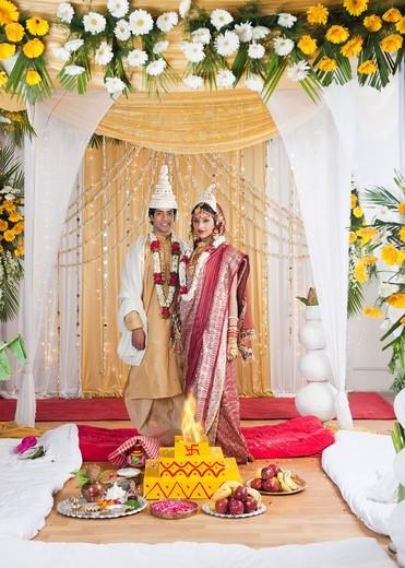Portrait of a newlywed couple in wedding mandap : Stock Photo