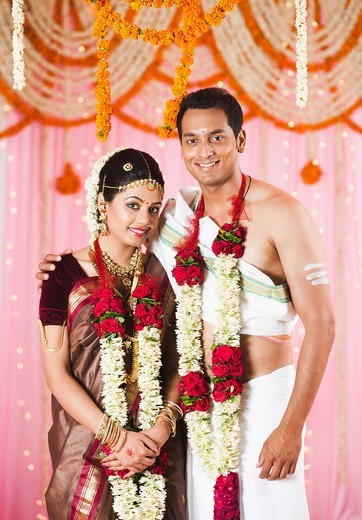 Stock Photo: 1846-13369 Portrait of a newlywed couple smiling at the wedding mandap