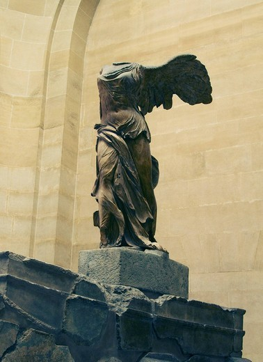 Statue of Winged Victory of Samothrace in a museum, Musee Du Louvre, Paris, France : Stock Photo