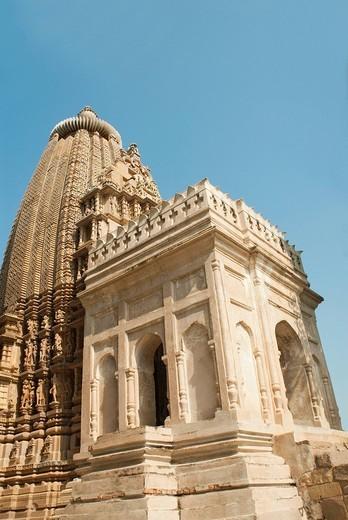 Low angle view of a temple, Adinath Temple, Khajuraho, Chhatarpur District, Madhya Pradesh, India : Stock Photo