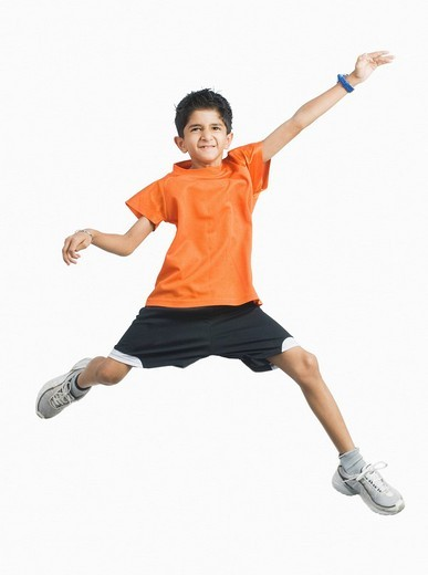 Stock Photo: 1846-1557 Portrait of a boy jumping and smiling