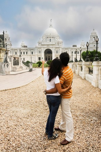 Stock Photo: 1846-1566 Couple looking at a memorial, Victoria Memorial, Kolkata, West Bengal, India