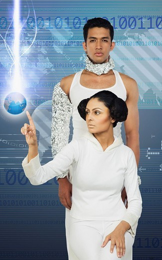 Woman using a touch screen with her boyfriend : Stock Photo