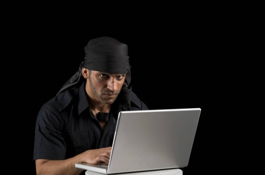 Stock Photo: 1846-1698 Actor portraying a villain using a laptop
