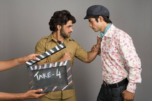 Actors portraying Gabbar Singh and Dev Anand on a movie set : Stock Photo