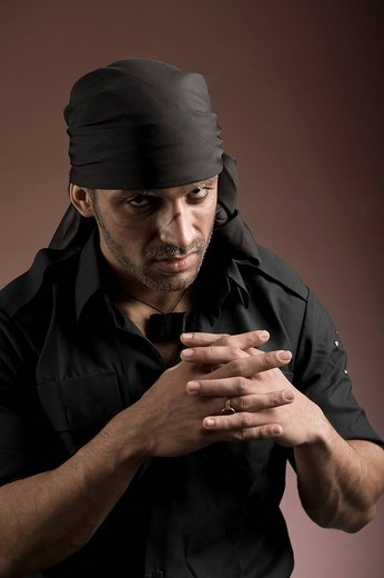Portrait of an actor portraying a villain : Stock Photo
