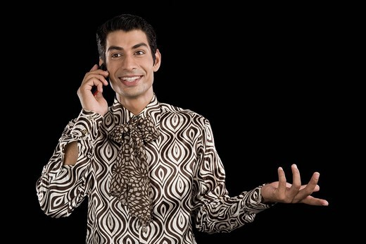 Man talking on a mobile phone : Stock Photo