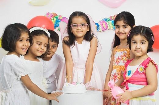 Stock Photo: 1846-1914 Children celebrating a birthday party