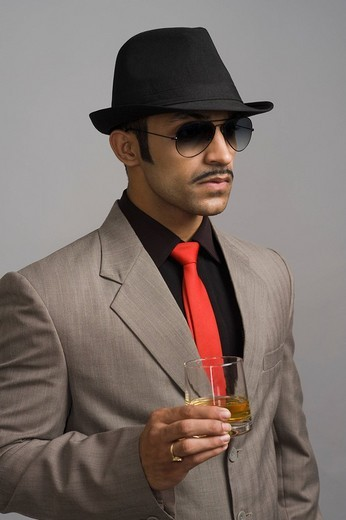 Actor portraying a businessman holding a wineglass : Stock Photo