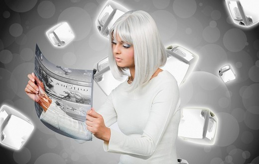 Woman examining a futuristic touch screen : Stock Photo