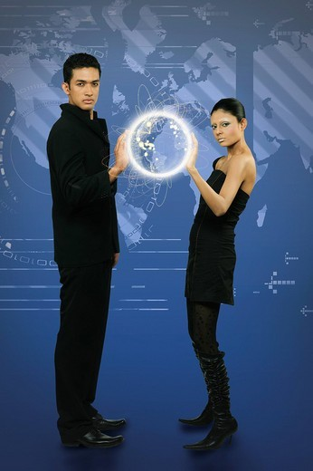 Couple holding a globe : Stock Photo