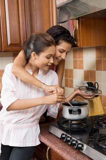 Lesbian couple cooking in the kitchen : Stock Photo