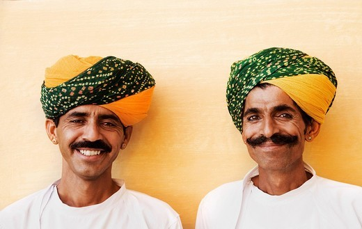 Portrait of two men smiling in a fort, Meherangarh Fort, Jodhpur, Rajasthan, India : Stock Photo