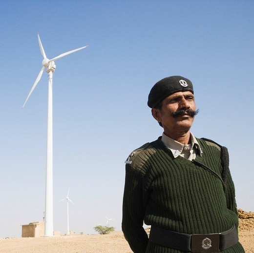 Stock Photo: 1846-3793 Soldier with a wind turbine in the background, Jaisalmer, Rajasthan, India