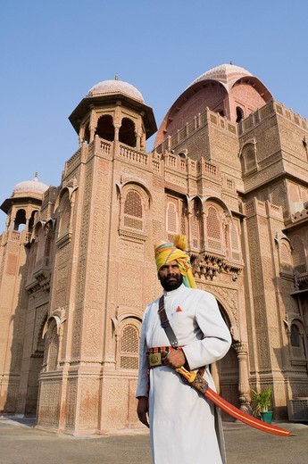 Security guard standing outside a palace, Laxmi Niwas Palace, Bikaner, Rajasthan, India : Stock Photo