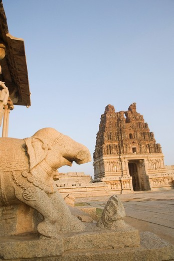 Stock Photo: 1846-4167 Stone Chariot with a temple in the background, Vitthala temple, Hampi, Karnataka, India
