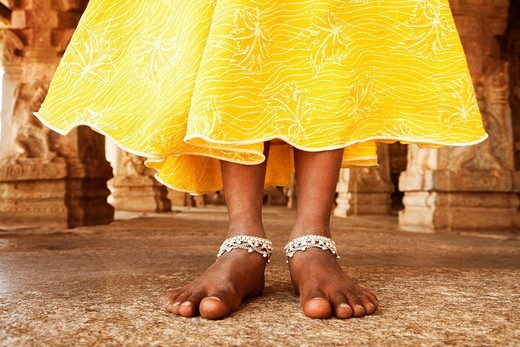 Low section view of a girl standing in a temple, Hampi, Karnataka, India : Stock Photo