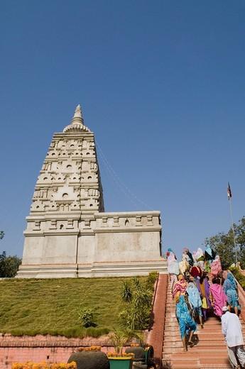 Group of pilgrims walking up on a staircase, Mahabodhi Temple, Bodhgaya, Gaya, Bihar, India : Stock Photo