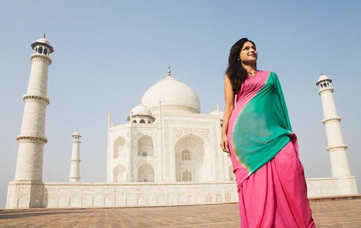 Woman standing in front of a mausoleum, Taj Mahal, Agra, Uttar Pradesh, India : Stock Photo