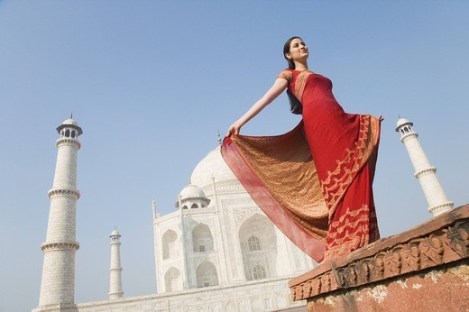 Stock Photo: 1846-5104 Woman standing in front of a mausoleum, Taj Mahal, Agra, Uttar Pradesh, India