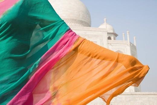 Stock Photo: 1846-5113 Woman with a mausoleum in the background, Taj Mahal, Agra, Uttar Pradesh, India