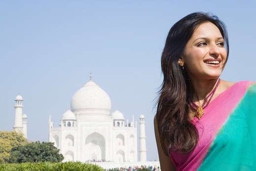 Stock Photo: 1846-5156 Woman smiling in front of a mausoleum, Taj Mahal, Agra, Uttar Pradesh, India