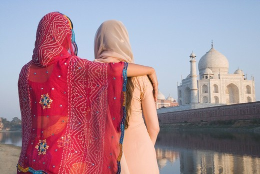 Stock Photo: 1846-5223 Rear view of two women with mausoleum in the background, Taj Mahal, Agra, Uttar Pradesh, India