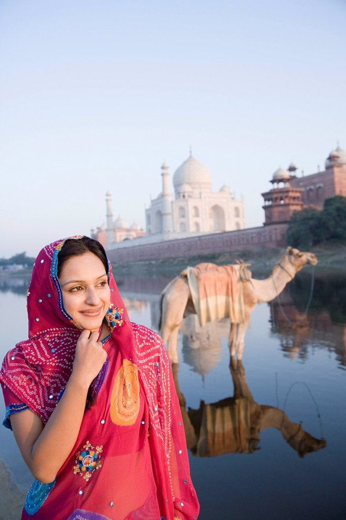 Woman at the riverbank with mausoleum in the background, Taj Mahal, Yamuna River, Agra, Uttar Pradesh, India : Stock Photo