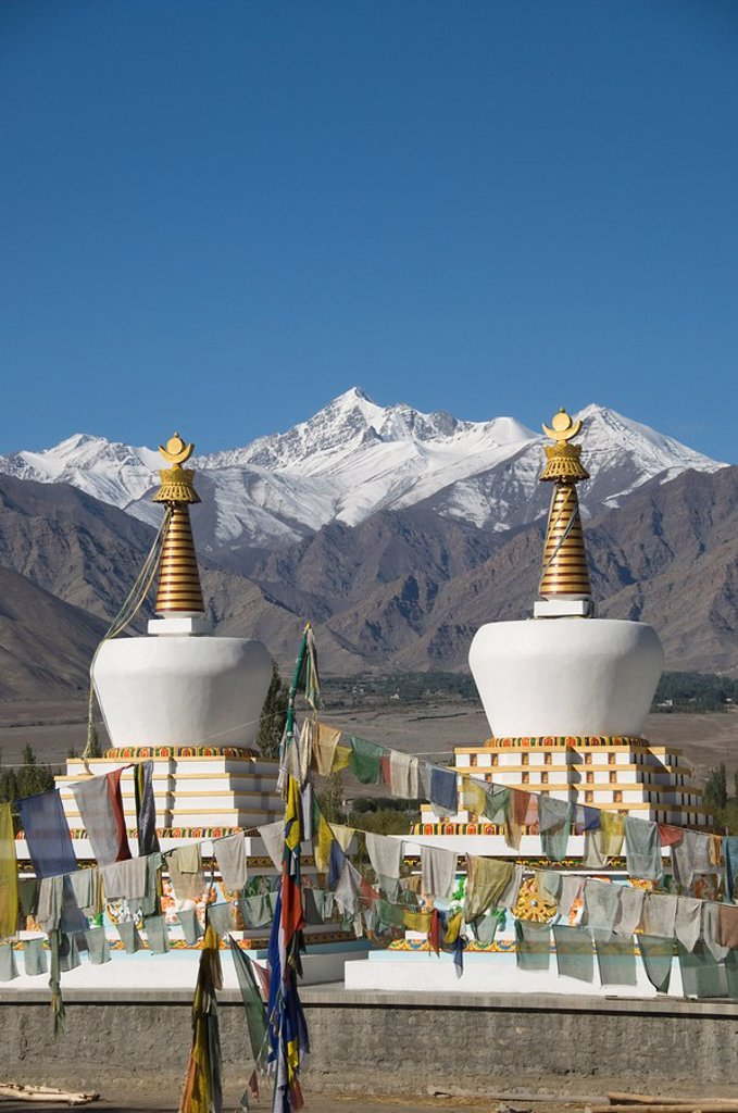 Prayer flags in front of chortens, Ladakh, Jammu and Kashmir, India : Stock Photo