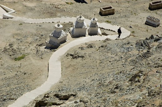 Stock Photo: 1846-5980 Person walking on a curve road, Leh, Ladakh, Jammu and Kashmir, India
