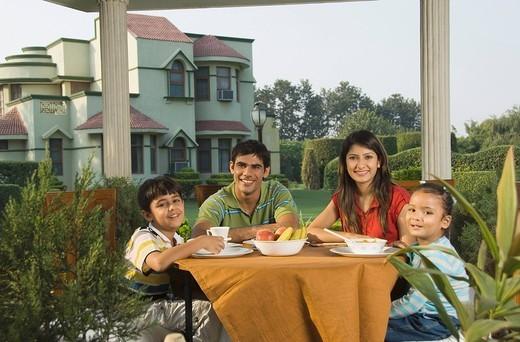 Family at a breakfast table, New Delhi, India : Stock Photo