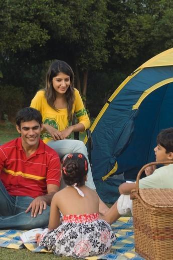 Family at a campsite, New Delhi, India : Stock Photo