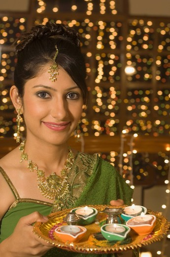 Woman holding a traditional Diwali thali : Stock Photo