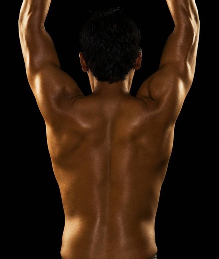 Rear view of a man exercising : Stock Photo