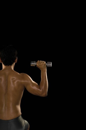 Stock Photo: 1846-6932 Rear view of a man exercising with dumbbells