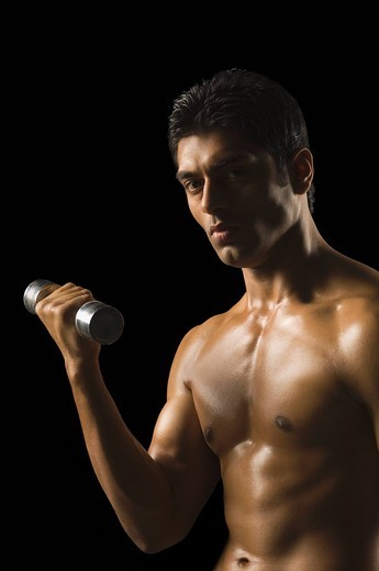 Man exercising with a dumbbell : Stock Photo
