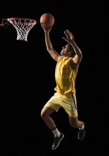 Stock Photo: 1846-7005 Basketball player shooting the basket