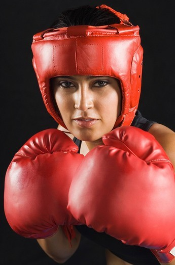 Stock Photo: 1846-7146 Portrait of a young woman playing boxing