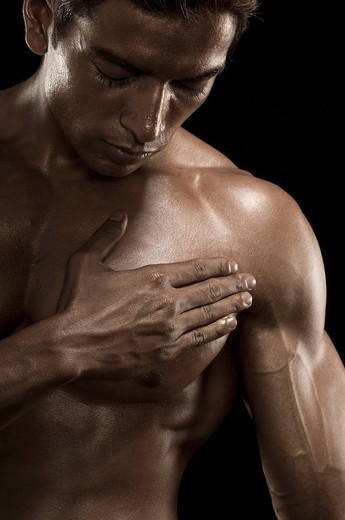 Close_up of a man flexing muscles : Stock Photo