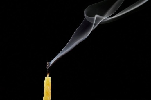 Stock Photo: 1846-7625 Smoke trailing from extinguished candle