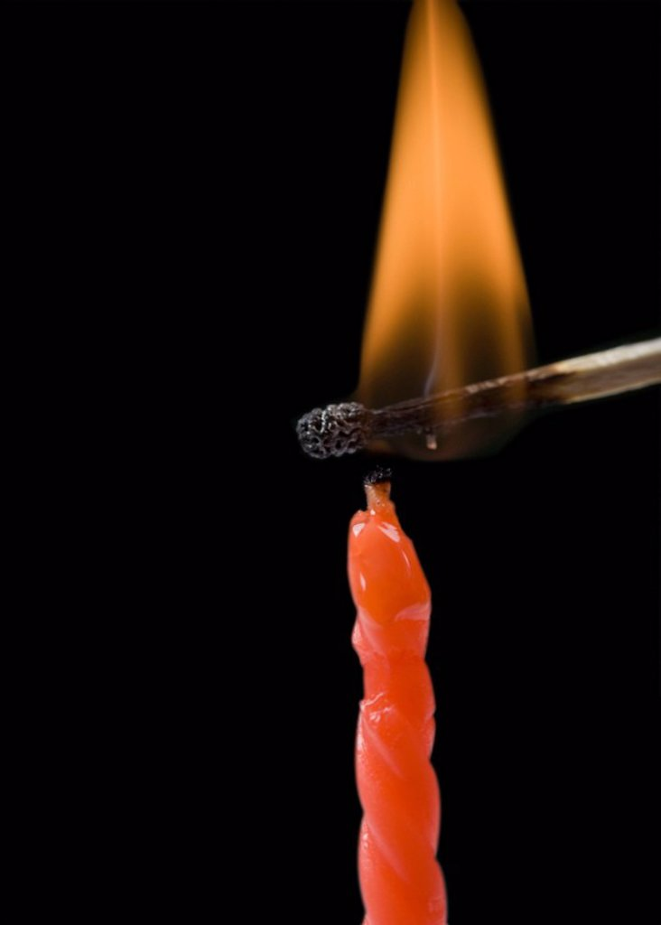 Stock Photo: 1846-7631 Matchstick lighting a birthday candle