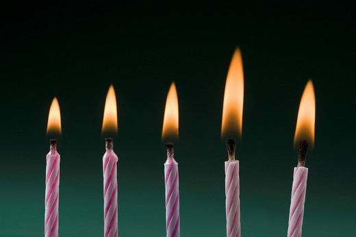 Close_up of burning birthday candles : Stock Photo