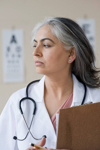 Stock Photo: 1846-7952 Close_up of a female doctor holding a clipboard, Gurgaon, Haryana, India